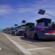 Bubba Wallace's No. 23 and others sit on pit road in NASCAR 21: Ignition