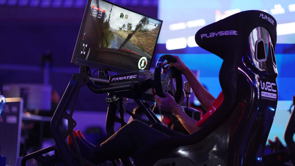 sim racer in action, 2021 WRC esports Grand Final